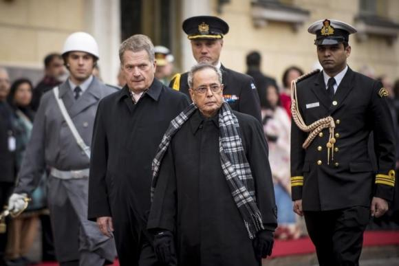 Indian President Pranab Mukherjee and his Finnish counterpart Sauli Niinisto review a guard of honour during an official welcoming ceremony in Helsinki