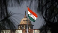 An Indian national flag flutters on top of the Indian parliament building in New Delhi