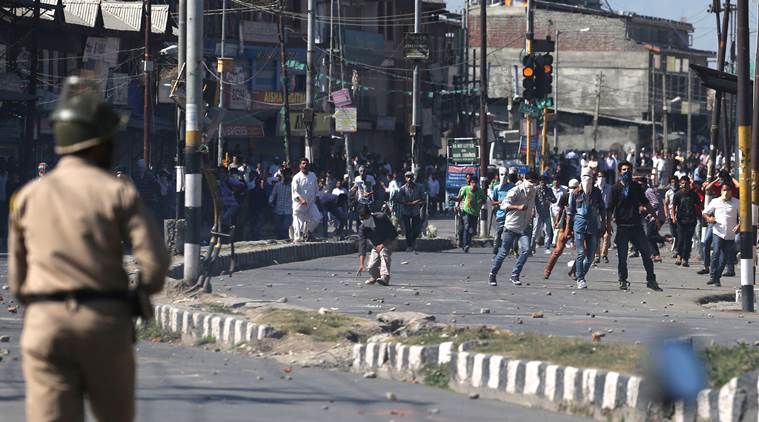 Protestors throw stones during a protest outside the Jamia Masjid, the main mosque in Srinagar on Friday, 11 September 2015. Express photo /Shuaib Masoodi