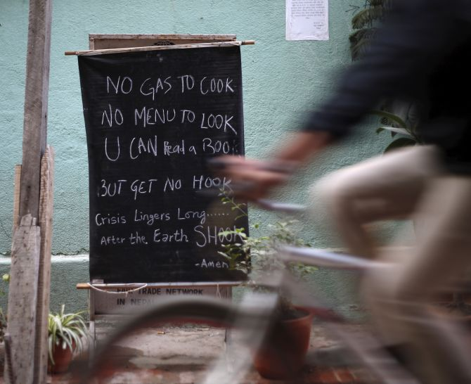 A notice is displayed outside the restaurant as fuel crisis continues in Kathmandu, Nepal October 6, 2015. Nepal started rationing fuel for vehicles on Sunday, said Nepal Oil Corp spokesman Deepak Baral, after trade ground to a halt at crossing points on the India-Nepal border. REUTERS/Navesh Chitrakar - RTS38RT