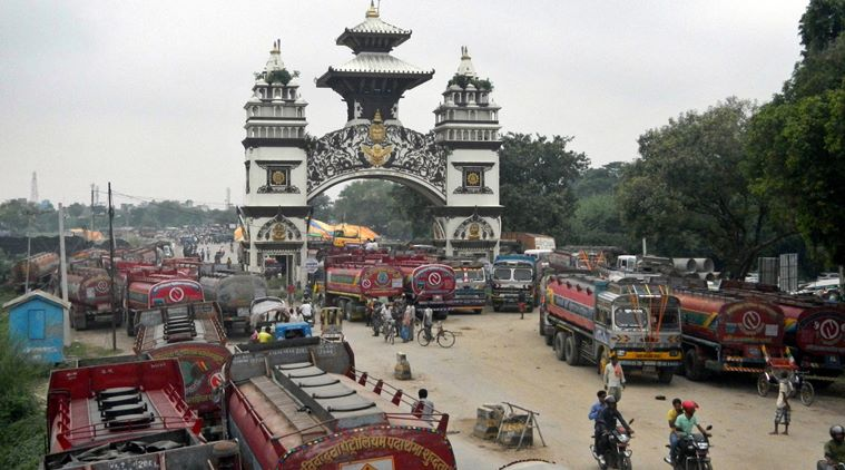 Nepalese oil tankers and commercial trucks stand stranded near a gate that marks the Nepalese border with India, in Birgunj, Nepal, Thursday, Sept. 24, 2015. Nepalís top political parties on Thursday reached out to protesters angry about the countryís new constitution, after violence in the region bordering India halted more than 1,000 oil tankers and trucks with essential supplies from entering Nepal. The disruption of traffic has raised fear of shortages in the Himalayan nation. (AP Photo/Ram Sarraf)