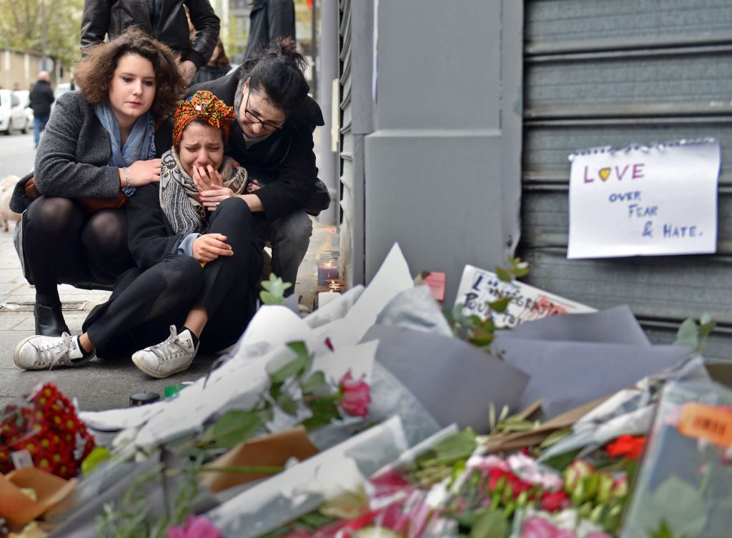 PARIS, FRANCE - NOVEMBER 14: A woman cries near Le Petit Cambodge restaurant, the day after a deadly attack on November 14, 2015 in Paris, France. At least 120 people have been killed and over 200 injured, 80 of which seriously, following a series of terrorist attacks in the French capital. (Photo by Antoine Antoniol/Getty Images) ORG XMIT: 591768109