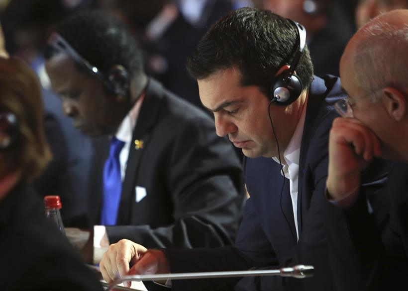 Greek Prime Minister Alexis Tsipras atends the opening ceremony of the COP21, United Nations Climate Change Conference, in Le Bourget, outside Paris, Monday, Nov. 30, 2015. (AP Photo/Thibault Camus, Pool)