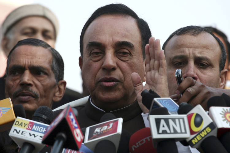 Subramanian Swamy, an opposition politician who brought the petition to revoke the telecom licences issued in 2008, speaks with the media after a verdict outside the Supreme Court in New Delhi February 2, 2012. India's Supreme Court on Thursday revoked all 122 telecoms licences issued under a scandal-tainted 2008 sale, a fresh embarrassment for the government and plunging the mobile network market of Asia's third-largest economy into uncertainty. REUTERS/Parivartan Sharma (INDIA - Tags: BUSINESS POLITICS TELECOMS) - RTR2X6TB