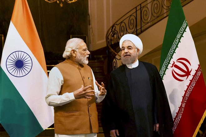 Prime Minister Narendra Modi with Ali Tayebnia, Iran's Minister of Economic Affairs and Finance on his arrival at Mehrabad airport in Tehran.