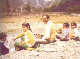 Karan, left, with his siblings – Priya, Priti and Anand – on an outing with their father, Surrendra Paul