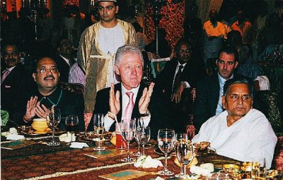 Former president Bill Clinton (center) traveled to India in 2005