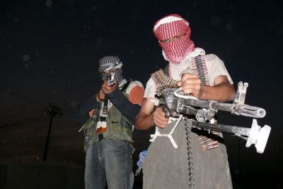 1280px-Iraqi_insurgents_with_guns_1
