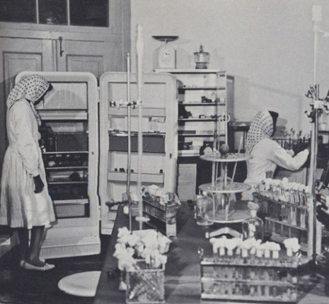 Afghan women in labs at vaccine research center.