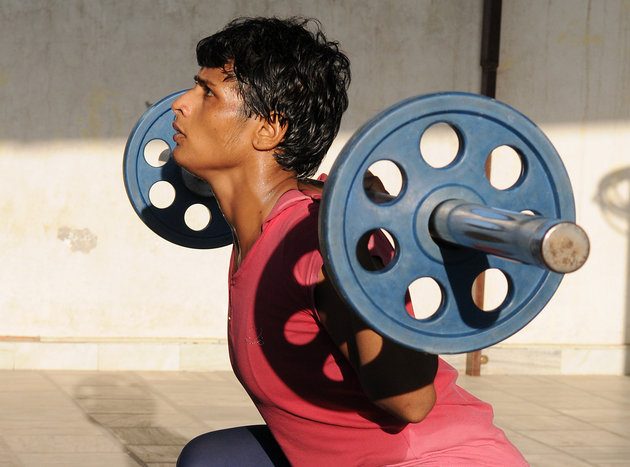 ROHTAK, INDIA - SEPTEMBER 24: International wrestler Neetu  training at Chotu Ram Stadium on September 24, 2015 in Rohtak, India. 21 year old wrestler Neetu from Bedwa village, Rohtak who was 13 when she was married at 13 and become mother when she was 14. Working several odd jobs to support her family she kept alive her dream of becoming an international wrestler. In August 21-year-old Neetu represented Inida at the Junior World Championships in Brazil. (Photo by Sanjeev Sharma/Hindustan Times )