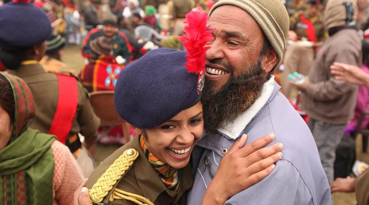 A freshly commissioned woman shares her joy with her father in the ITBP 'passing out parade' in Panchkula