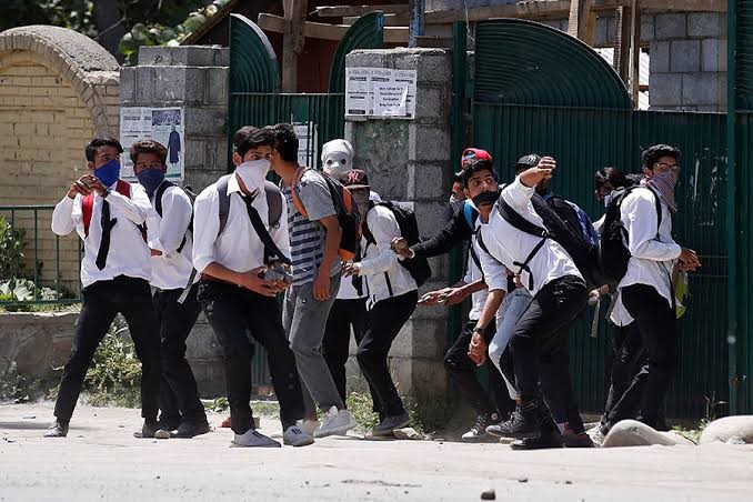 Students pelting stones on the Indian armed forces in Kashmir